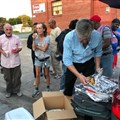 On a hot summer evening, Mike Rice takes leftovers from a meeting at St. Elmo United Methodist Church to people congregating near a homeless shelter.