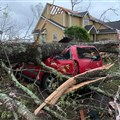 An early-morning storm destroyed the home and car of Scott and Susan Farley, driving them and their two daughters outside for the night. Photo by Troy Hamilton.