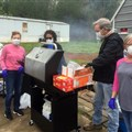 Benton United Methodist Church shares a cookout with a mobile-home park in March, shortly before stay-at-home orders. From left to right: Donna Calhoun, Tepa Bigham, Jacky Calhoun, and Kim Farner.